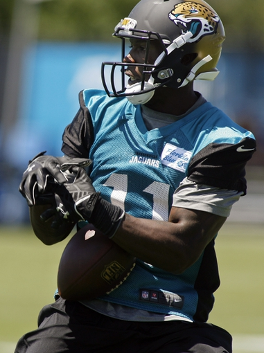 May 16, 2014; Jacksonville, FL, USA; Jacksonville Jaguars wide receiver Marqise Lee (11) pulls in a pass during rookie minicamp at Florida Blue Health and Wellness Practice Fields. Mandatory Credit: Phil Sears-USA TODAY Sports