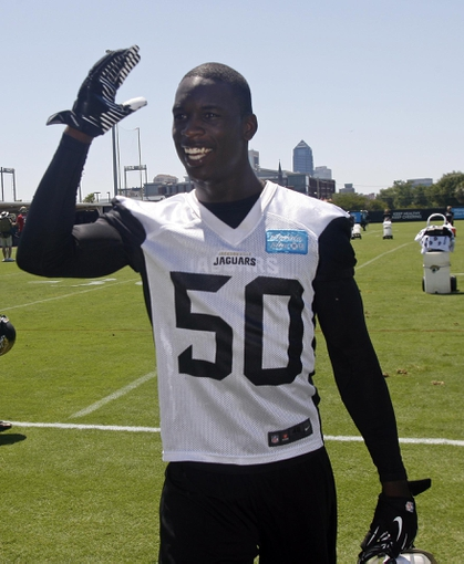 May 16, 2014; Jacksonville, FL, USA; Jacksonville Jaguars linebacker Telvin Smith (50) gestures towards fans after rookie minicamp at Florida Blue Health and Wellness Practice Fields. Mandatory Credit: Phil Sears-USA TODAY Sports