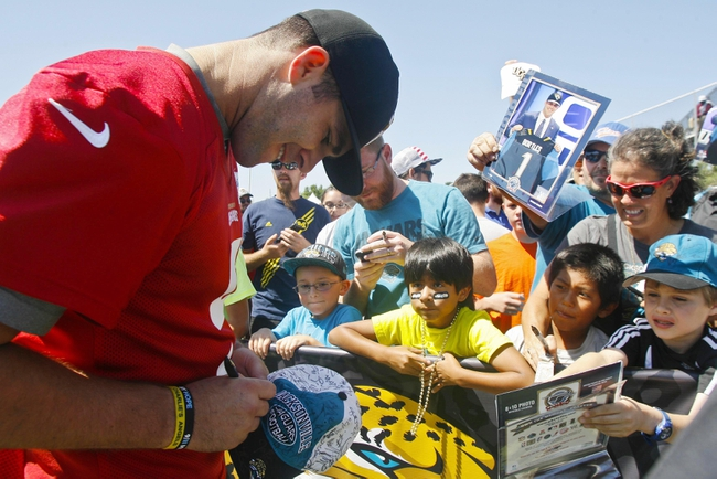 May 16, 2014; Jacksonville, FL, USA;Jacksonville Jaguars quarterback Blake Bortles (5) signs autographs for fans after rookie minicamp at Florida Blue Health and Wellness Practice Fields. Mandatory Credit: Phil Sears-USA TODAY Sports