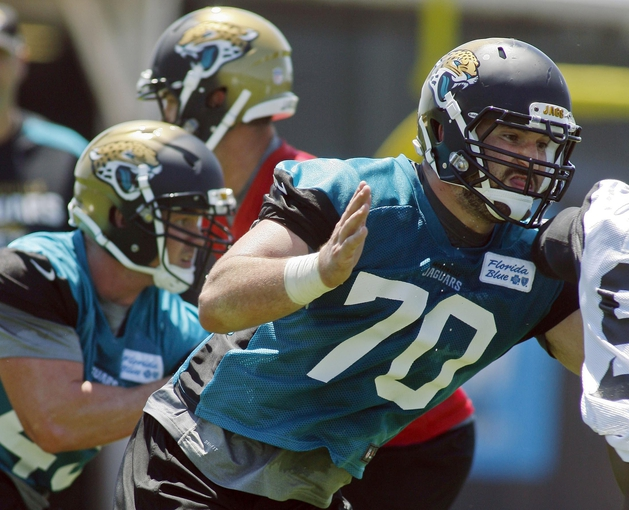 May 16, 2014; Jacksonville, FL, USA; Jacksonville Jaguars center Luke Bowanko (70) blocks during rookie minicamp at Florida Blue Health and Wellness Practice Fields. Mandatory Credit: Phil Sears-USA TODAY Sports