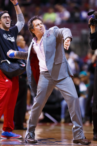 Mar 28, 2014; Auburn Hills, MI, USA; Piston owner Tom Gores throws mini baseballs into the crowd during a time out against the Miami Heat at The Palace of Auburn Hills. Mandatory Credit: Rick Osentoski-USA TODAY Sports
