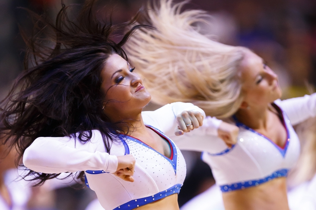 Mar 28, 2014; Auburn Hills, MI, USA; Detroit Pistons dancer perform during a time out against the Miami Heat at The Palace of Auburn Hills. Mandatory Credit: Rick Osentoski-USA TODAY Sports