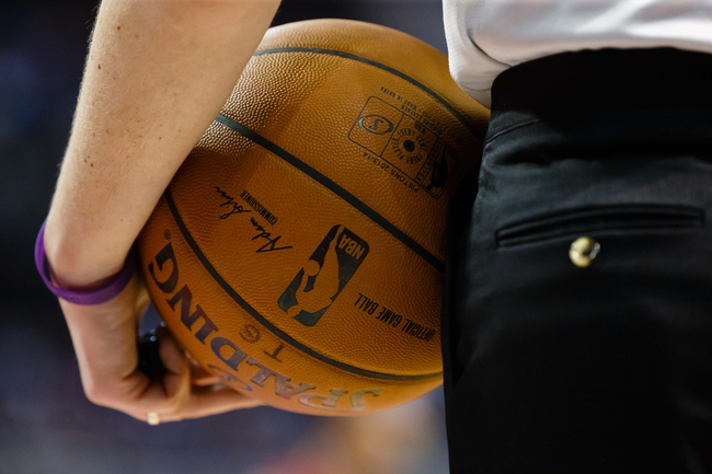 Mar 28, 2014; Auburn Hills, MI, USA; Referee holds a baseball during the game between the Detroit Pistons and the Miami Heat at The Palace of Auburn Hills. Mandatory Credit: Rick Osentoski-USA TODAY Sports