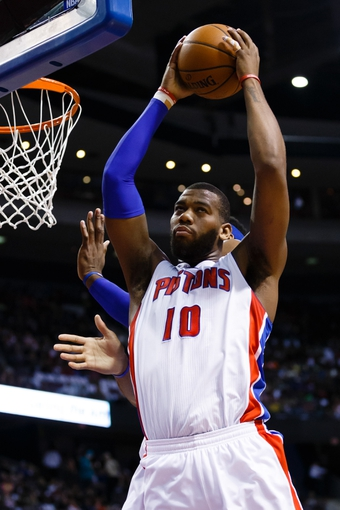 Mar 28, 2014; Auburn Hills, MI, USA; Detroit Pistons forward Greg Monroe (10) grabs the rebound against the Miami Heat at The Palace of Auburn Hills. Mandatory Credit: Rick Osentoski-USA TODAY Sports