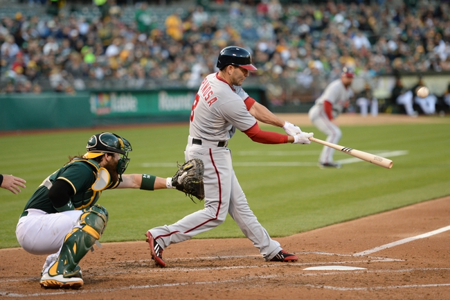 May 9, 2014; Oakland, CA, USA; Washington Nationals second baseman Danny Espinosa (8) bats against Oakland Athletics catcher Derek Norris (36, left) during the second inning at O.co Coliseum. The Athletics defeated the Nationals 8-0.  Mandatory Credit: Kyle Terada-USA TODAY Sports