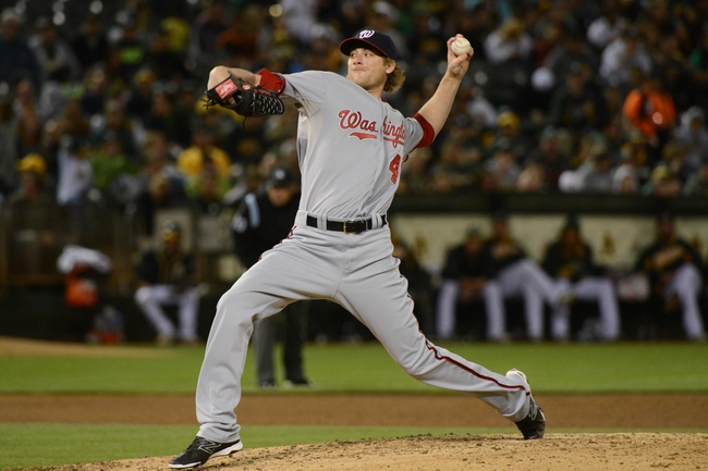 May 9, 2014; Oakland, CA, USA; Washington Nationals relief pitcher Ross Detwiler (48) delivers a pitch against the Oakland Athletics during the fifth inning at O.co Coliseum. The Athletics defeated the Nationals 8-0.  Mandatory Credit: Kyle Terada-USA TODAY Sports