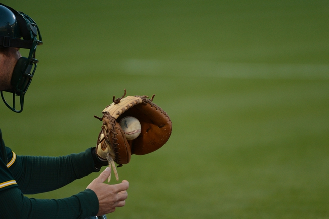 May 10, 2014; Oakland, CA, USA; Detail view of a baseball and glove worn by Oakland Athletics catcher John Jaso (5, not pictured) during the sixth inning against the Washington Nationals at O.co Coliseum. The Athletics defeated the Nationals 4-3 in 10 innings. Mandatory Credit: Kyle Terada-USA TODAY Sports