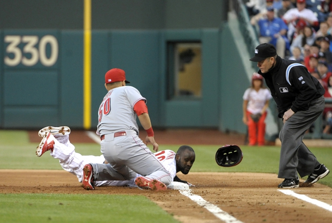 May 17, 2014; Philadelphia, PA, USA; Philadelphia Phillies center fielder Tony Gwynn (19) dives safely back into first base ahead of tag by Cincinnati Reds catcher Neftali Soto (50) in the second inning at Citizens Bank Park. Mandatory Credit: Eric Hartline-USA TODAY Sports