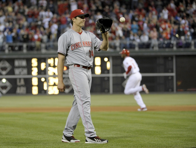 May 17, 2014; Philadelphia, PA, USA;  Cincinnati Reds starting pitcher Homer Bailey (34) reacts after allowing a home run to Philadelphia Phillies left fielder Domonic Brown (9) in the fourth inning at Citizens Bank Park. Mandatory Credit: Eric Hartline-USA TODAY Sports