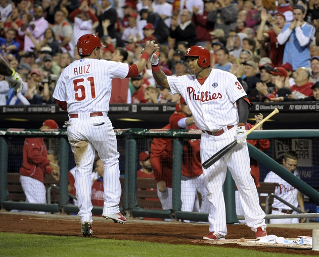May 17, 2014; Philadelphia, PA, USA; Philadelphia Phillies catcher Carlos Ruiz (51) celebrates with right fielder Marlon Byrd (3) after scoring a run in the fourth inning against the Cincinnati Reds at Citizens Bank Park. Mandatory Credit: Eric Hartline-USA TODAY Sports