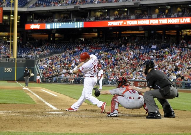 May 17, 2014; Philadelphia, PA, USA; Philadelphia Phillies third baseman Cody Asche (25) hits a 2-RBI double in the fourth inning against the Cincinnati Reds at Citizens Bank Park. Mandatory Credit: Eric Hartline-USA TODAY Sports