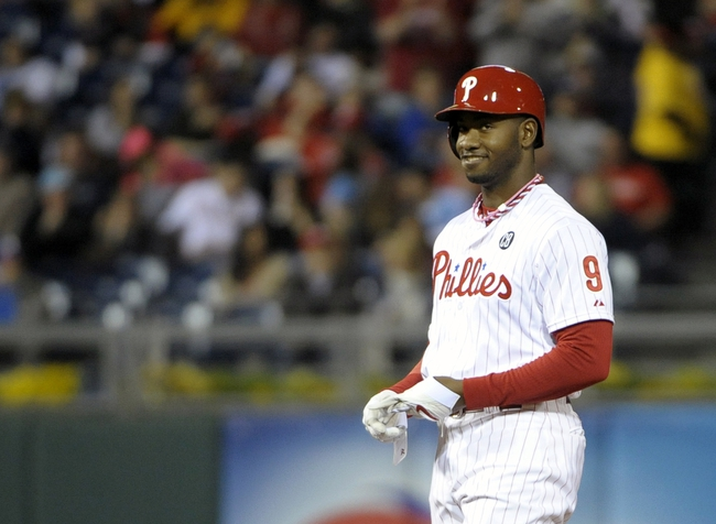May 17, 2014; Philadelphia, PA, USA; Philadelphia Phillies left fielder Domonic Brown (9) stands on second base after hitting a 3 RBI double in the seventh inning against the Cincinnati Reds at Citizens Bank Park. Brown had 5 RBI in the game. The Phillies defeated the Reds, 12-1. Mandatory Credit: Eric Hartline-USA TODAY Sports