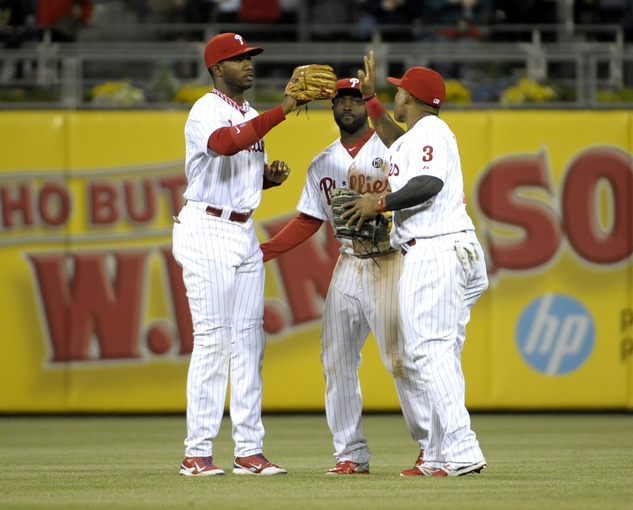 May 17, 2014; Philadelphia, PA, USA;  Philadelphia Phillies left fielder Domonic Brown (9), center fielder Tony Gwynn (19) and right fielder Marlon Byrd (3) celebrate their win against the Cincinnati Reds at Citizens Bank Park. The Phillies defeated the Reds, 12-1. Mandatory Credit: Eric Hartline-USA TODAY Sports