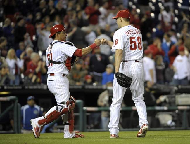 May 17, 2014; Philadelphia, PA, USA; Philadelphia Phillies catcher Carlos Ruiz (51) and relief pitcher Jonathan Papelbon (58) celebrate win against the Cincinnati Reds at Citizens Bank Park. The Phillies defeated the Reds, 12-1. Mandatory Credit: Eric Hartline-USA TODAY Sports