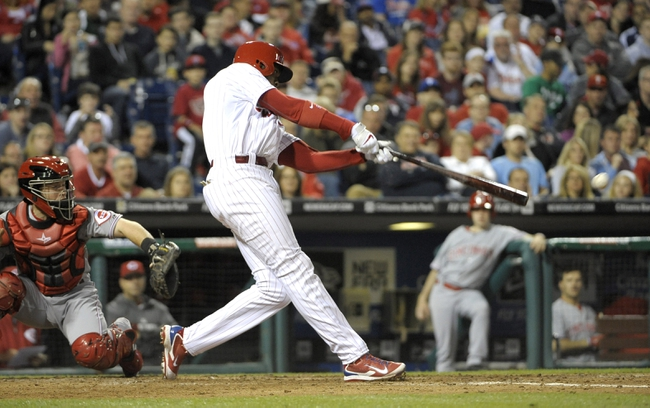 May 17, 2014; Philadelphia, PA, USA; Philadelphia Phillies left fielder Domonic Brown (9) hits a 3 RBI double in the seventh inning against the Cincinnati Reds at Citizens Bank Park. The Phillies defeated the Reds, 12-1. Mandatory Credit: Eric Hartline-USA TODAY Sports