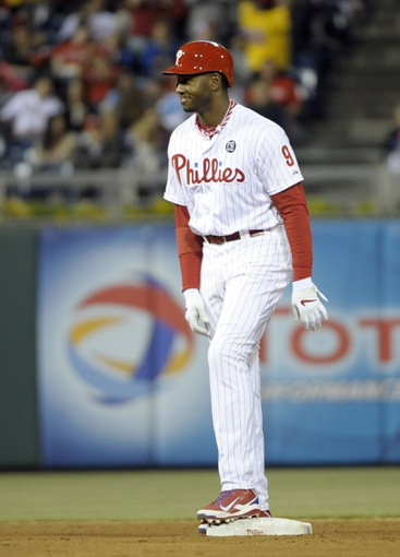 May 17, 2014; Philadelphia, PA, USA; Philadelphia Phillies left fielder Domonic Brown (9) stands on second base after hitting a 3 RBI double in the seventh inning against the Cincinnati Reds at Citizens Bank Park.  The Phillies defeated the Reds, 12-1. Mandatory Credit: Eric Hartline-USA TODAY Sports