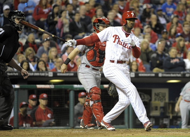 May 17, 2014; Philadelphia, PA, USA; Philadelphia Phillies left fielder Domonic Brown (9) watches his 3-RBI double in the seventh inning against the Cincinnati Reds at Citizens Bank Park. The Phillies defeated the Reds, 12-1. Mandatory Credit: Eric Hartline-USA TODAY Sports