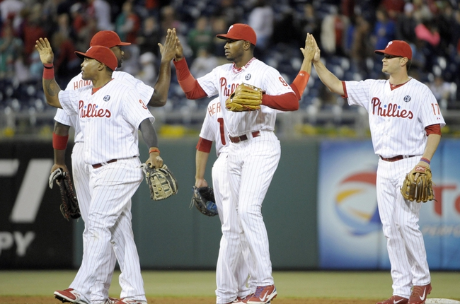 May 17, 2014; Philadelphia, PA, USA; Philadelphia Phillies right fielder Marlon Byrd (3), left fielder Domonic Brown (9) and shortstop Reid Brignac (17) celebrate a win against the Cincinnati Reds at Citizens Bank Park. The Phillies defeated the Reds, 12-1. Mandatory Credit: Eric Hartline-USA TODAY Sports