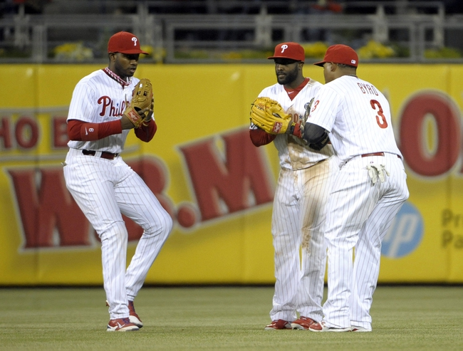 May 17, 2014; Philadelphia, PA, USA;  Philadelphia Phillies left fielder Domonic Brown (9), center fielder Tony Gwynn (19) and right fielder Marlon Byrd (3) celebrate a win against the Cincinnati Reds at Citizens Bank Park. The Phillies defeated the Reds, 12-1. Mandatory Credit: Eric Hartline-USA TODAY Sports