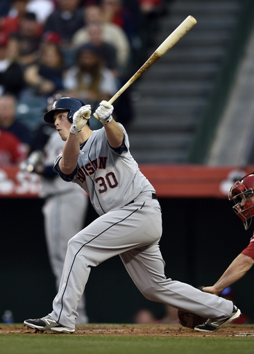 May 19, 2014; Anaheim, CA, USA; Houston Astros third baseman Matt Dominguez (30) hits a RBI single during the first inning against the Los Angeles Angels at Angel Stadium of Anaheim. Mandatory Credit: Kelvin Kuo-USA TODAY Sports