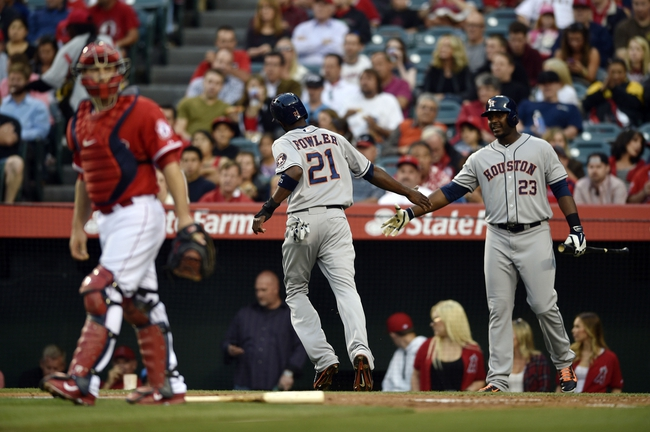 May 19, 2014; Anaheim, CA, USA; Houston Astros center fielder Dexter Fowler (21) celebrates with designated hitter Chris Carter (23) after scoringduring the first inning against the Los Angeles Angels at Angel Stadium of Anaheim. Mandatory Credit: Kelvin Kuo-USA TODAY Sports