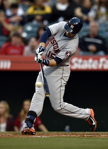 May 19, 2014; Anaheim, CA, USA; Houston Astros catcher Jason Castro (15) hits a RBI single during the first inning against the Los Angeles Angels at Angel Stadium of Anaheim. Mandatory Credit: Kelvin Kuo-USA TODAY Sports