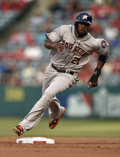 May 19, 2014; Anaheim, CA, USA; Houston Astros center fielder Dexter Fowler (21) rounds second base off of a single by catcher Jason Castro (not pictured) during the first inning against the Los Angeles Angels at Angel Stadium of Anaheim. Mandatory Credit: Kelvin Kuo-USA TODAY Sports