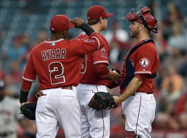 May 19, 2014; Anaheim, CA, USA; Los Angeles Angels catcher Chris Ianetta (right) talks with starting pitcher Garrett Richards (center) during the first inning against the Houston Astros at Angel Stadium of Anaheim. Mandatory Credit: Kelvin Kuo-USA TODAY Sports