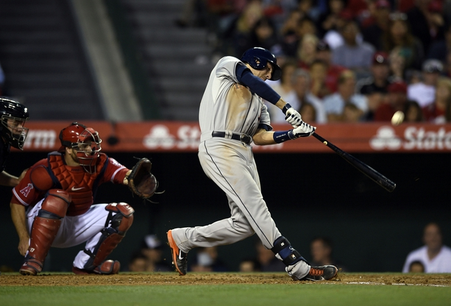 May 19, 2014; Anaheim, CA, USA; Houston Astros catcher Jason Castro (15) hits a double during the third inning against the Los Angeles Angels at Angel Stadium of Anaheim. Mandatory Credit: Kelvin Kuo-USA TODAY Sports