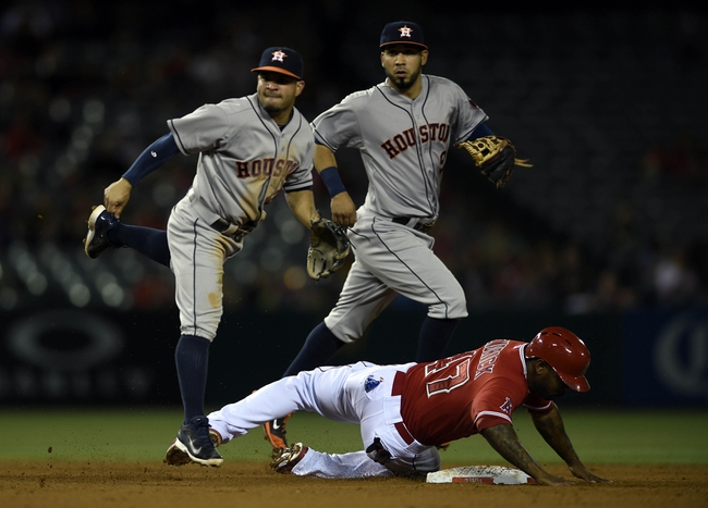 May 19, 2014; Anaheim, CA, USA; Houston Astros second baseman Jose Altuve (27) moves out of the way of Los Angeles Angels second baseman Howie Kendrick (47) to complete the double play during the fourth inning at Angel Stadium of Anaheim. Mandatory Credit: Kelvin Kuo-USA TODAY Sports