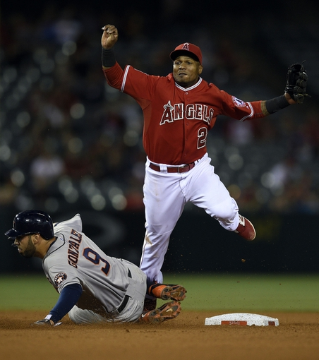 May 19, 2014; Anaheim, CA, USA; Los Angeles Angels short stop Erick Aybar (2) attempts to avoid a slide from Houston Astros shortstop Marwin Gonzalez (9) while completing the double play during the seventh inning at Angel Stadium of Anaheim. Mandatory Credit: Kelvin Kuo-USA TODAY Sports