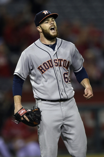 May 19, 2014; Anaheim, CA, USA; Houston Astros starting pitcher Dallas Keuchel (60) reacts after allowing an infield single to Los Angeles Angels center fielder Mike Trout (not pictured) during the ninth inning at Angel Stadium of Anaheim. The Houston Astros won 6-2. Mandatory Credit: Kelvin Kuo-USA TODAY Sports