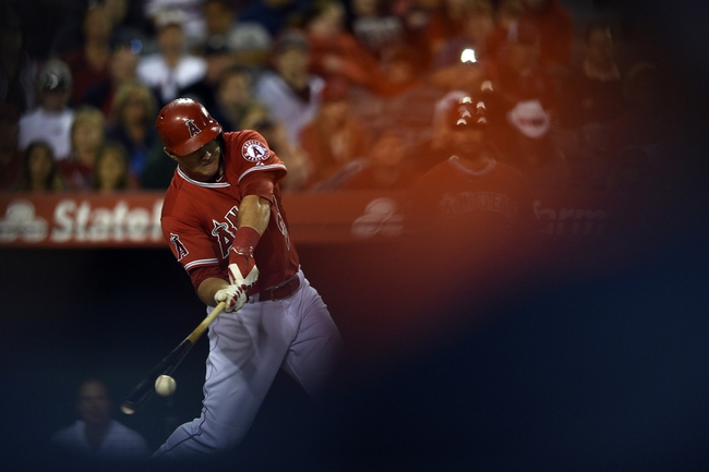 May 19, 2014; Anaheim, CA, USA; Los Angeles Angels center fielder Mike Trout (27) hits a single during the ninth inning against the Houston Astros at Angel Stadium of Anaheim. The Houston Astros won 6-2. Mandatory Credit: Kelvin Kuo-USA TODAY Sports
