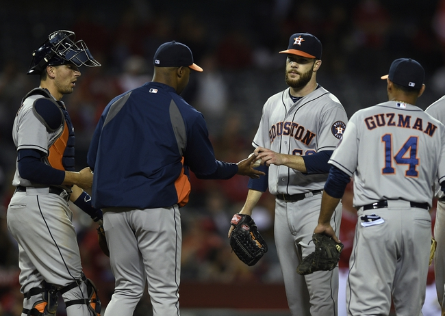May 19, 2014; Anaheim, CA, USA; Houston Astros starting pitcher Dallas Keuchel (center) is taken out of the game during the ninth inning against the Los Angeles Angels at Angel Stadium of Anaheim. The Houston Astros won 6-2. Mandatory Credit: Kelvin Kuo-USA TODAY Sports