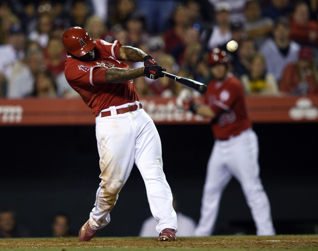 May 19, 2014; Anaheim, CA, USA; Los Angeles Angels second baseman Howie Kendrick (47) hits a two RBI triple during the ninth inning against the Houston Astros at Angel Stadium of Anaheim. The Houston Astros won 6-2. Mandatory Credit: Kelvin Kuo-USA TODAY Sports
