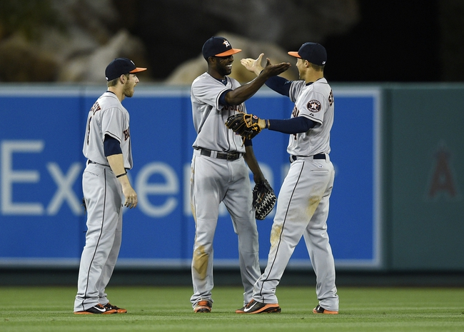 May 19, 2014; Anaheim, CA, USA; Houston Astros center fielder Dexter Fowler (center) celebrates with right fielder George Springer (right) after the game against the Los Angeles Angels at Angel Stadium of Anaheim. The Houston Astros won 6-2. Mandatory Credit: Kelvin Kuo-USA TODAY Sports
