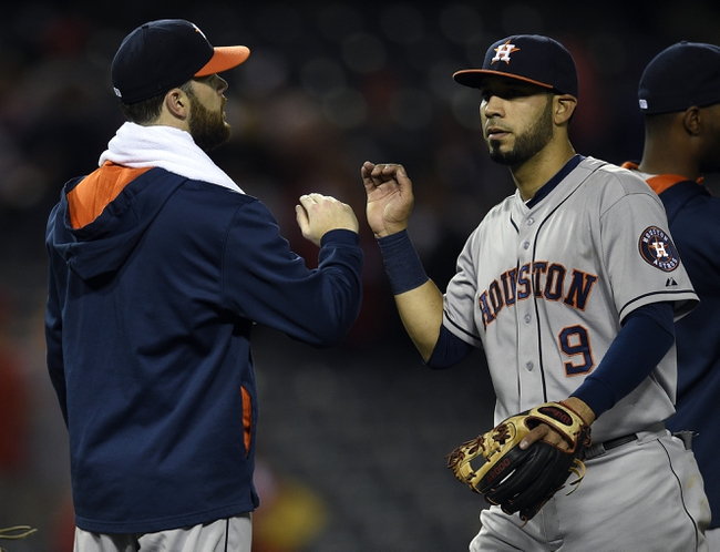 May 19, 2014; Anaheim, CA, USA; Houston Astros starting pitcher Dallas Keuchel (left) celebrates with shortstop Marwin Gonzalez (right) after the game against the Los Angeles Angels at Angel Stadium of Anaheim. The Houston Astros won 6-2. Mandatory Credit: Kelvin Kuo-USA TODAY Sports