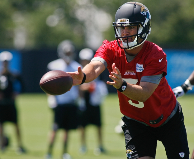 May 16, 2014; Jacksonville, FL, USA; Jacksonville Jaguars quarterback Blake Bortles (5) pitches out the ball during Rookie Minicamp at Florida Blue Health and Wellness Practice Fields. Mandatory Credit: Phil Sears-USA TODAY Sports