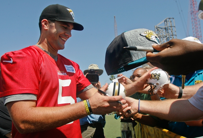 May 16, 2014; Jacksonville, FL, USA; Jacksonville Jaguars quarterback Blake Bortles (5) autographs mini helmets for fans after Rookie Minicamp at Florida Blue Health and Wellness Practice Fields. Mandatory Credit: Phil Sears-USA TODAY Sports