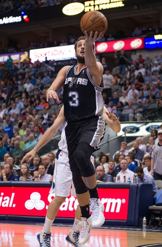 Apr 10, 2014; Dallas, TX, USA; San Antonio Spurs guard Marco Belinelli (3) during the game against the Dallas Mavericks at the American Airlines Center. The Spurs defeated the Mavericks 109-100. Mandatory Credit: Jerome Miron-USA TODAY Sports