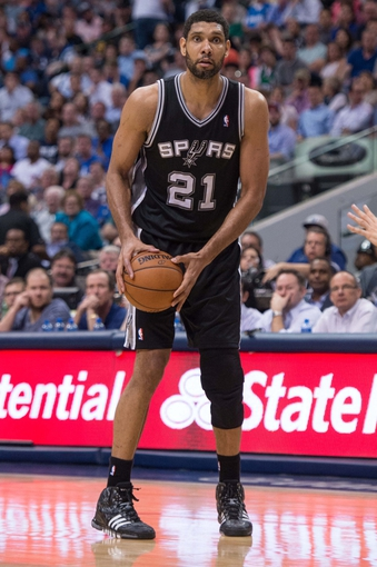 Apr 10, 2014; Dallas, TX, USA; San Antonio Spurs forward Tim Duncan (21) during the game against the Dallas Mavericks at the American Airlines Center. The Spurs defeated the Mavericks 109-100. Mandatory Credit: Jerome Miron-USA TODAY Sports