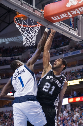 Apr 10, 2014; Dallas, TX, USA; Dallas Mavericks center Samuel Dalembert (1) and San Antonio Spurs forward Tim Duncan (21) during the game at the American Airlines Center. The Spurs defeated the Mavericks 109-100. Mandatory Credit: Jerome Miron-USA TODAY Sports