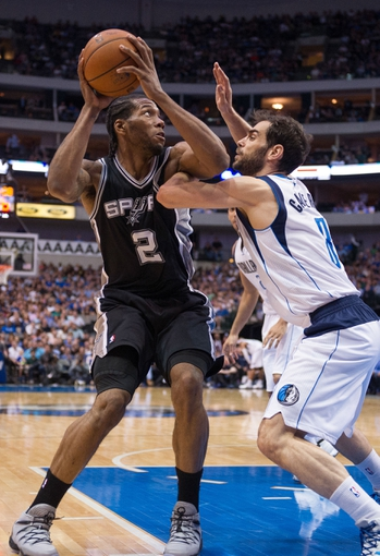 Apr 10, 2014; Dallas, TX, USA; San Antonio Spurs forward Kawhi Leonard (2) and Dallas Mavericks guard Jose Calderon (8) during the game at the American Airlines Center. The Spurs defeated the Mavericks 109-100. Mandatory Credit: Jerome Miron-USA TODAY Sports