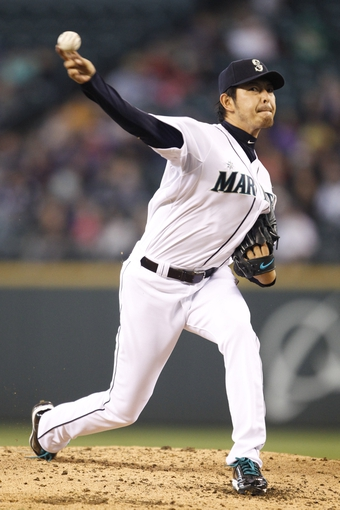 May 25, 2014; Seattle, WA, USA; Seattle Mariners pitcher Hisashi Iwakuma (18) delivers to the plate against the Houston Astros during the third inning at Safeco Field. Mandatory Credit: Joe Nicholson-USA TODAY Sports
