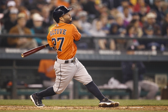 May 25, 2014; Seattle, WA, USA; Houston Astros second baseman Jose Altuve (27) singles against the Seattle Mariners during the sixth inning at Safeco Field. Mandatory Credit: Joe Nicholson-USA TODAY Sports