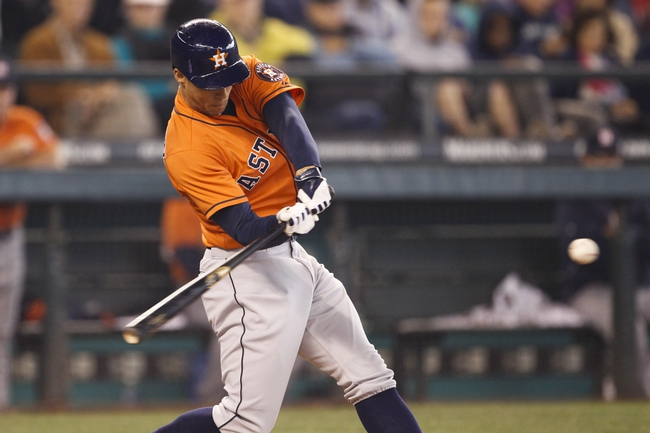 May 25, 2014; Seattle, WA, USA; Houston Astros right fielder George Springer (4) hits a two-run homer against the Seattle Mariners during the sixth inning at Safeco Field. Mandatory Credit: Joe Nicholson-USA TODAY Sports