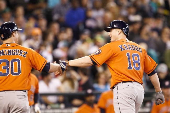 May 25, 2014; Seattle, WA, USA; Houston Astros first baseman Marc Krauss (18) is greeted at home by third baseman Matt Dominguez (30) after hitting a two-run homer against the Seattle Mariners during the seventh inning at Safeco Field. Mandatory Credit: Joe Nicholson-USA TODAY Sports