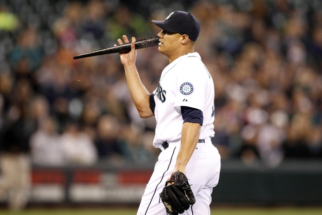 May 25, 2014; Seattle, WA, USA; Seattle Mariners pitcher Yoervis Medina (31) holds a shard of a broken bat as he walks back to the dugout following the ninth inning against the Houston Astros at Safeco Field. Mandatory Credit: Joe Nicholson-USA TODAY Sports