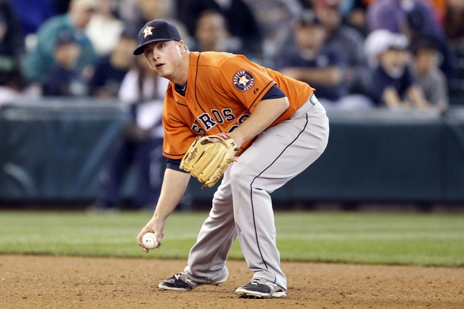 May 25, 2014; Seattle, WA, USA; Houston Astros third baseman Matt Dominguez (30) picks up a grounder ball and throws to first base against the Seattle Mariners during the ninth inning at Safeco Field. Mandatory Credit: Joe Nicholson-USA TODAY Sports