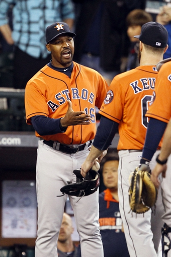 May 25, 2014; Seattle, WA, USA; Houston Astros manager Bo Porter (16) greets pitcher Dallas Keuchel (60) following the final out of a 4-1 victory over the Seattle Mariners at Safeco Field. Mandatory Credit: Joe Nicholson-USA TODAY Sports